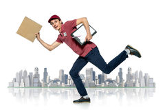 Delivery boy in a rush delivering a package. Isolated against white background stock images