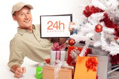 24 Hour Express Delivery, Even On Christmas!. This delivery boy will work on x-mas, just to bring you your gifts in time Royalty Free Stock Photos