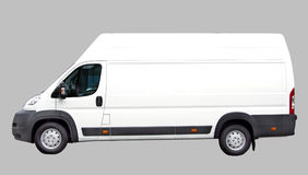 Delivery car isolated on grey. White delivery van isolated on grey Royalty Free Stock Image