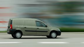 Delivery car in motion Stock Images