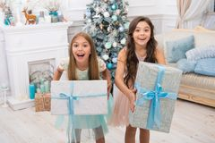 Delivery christmas gifts. little children girls with xmas present. happy new year. happy little sisters celebrate winter. Holiday. christmas time. Family. All I royalty free stock image