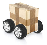 Delivery concept. Cardboard box on wheels Royalty Free Stock Photo