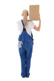 Delivery concept -  back view of woman in blue workwear with car Stock Photography