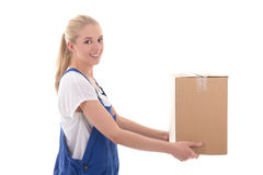 Delivery concept - happy woman in blue workwear giving cardboard Royalty Free Stock Images