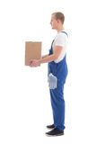 Delivery concept - side view of man in workwear with cardboard b Royalty Free Stock Photo