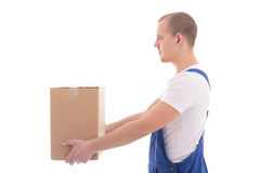 Delivery concept - side view of man in workwear giving cardboard Royalty Free Stock Photos