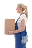 Delivery concept - side view of woman in blue workwear with card Stock Photos