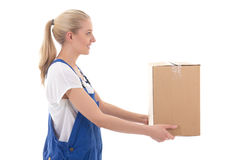 Delivery concept - side view of woman in blue workwear giving ca Stock Image
