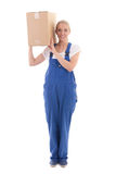 Delivery concept -  woman in blue workwear with cardboard box on Stock Photos