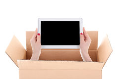 Delivery concept - woman hands holding tablet pc with copyspace Stock Photo