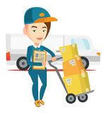 Delivery courier with cardboard boxes. Royalty Free Stock Image