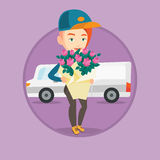 Delivery courier holding bouquet of flowers. Stock Image