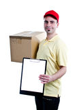 Delivery courier man. A smiling delivery man bringing a package and holding out a clipboard - isolated on white background Stock Photo