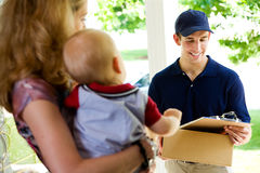 Delivery: Deliveryman Checking Name on List Royalty Free Stock Photos