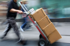 Delivery with dolly by hand. Delivery goods with dolly by hand, purposely motion blur Royalty Free Stock Photos