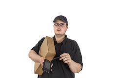 Delivery driver asks customer to sign Stock Images