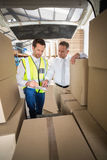 Delivery driver checking his list on clipboard Royalty Free Stock Images