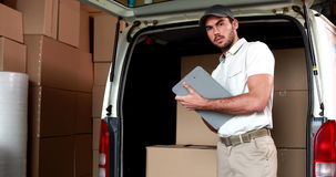 Delivery driver checking his list stock footage