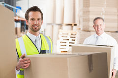 Delivery driver loading his van with boxes. Outside the warehouse Royalty Free Stock Photos