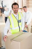 Delivery driver loading his van with boxes. Outside the warehouse Stock Photos