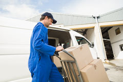 Delivery driver packing his van Royalty Free Stock Photography