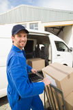 Delivery driver packing his van Royalty Free Stock Photos