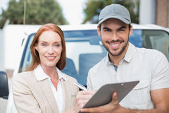Delivery driver showing where to sign to customer Royalty Free Stock Images