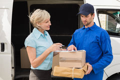 Delivery driver showing where to sign to customer Stock Photo
