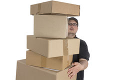 Delivery driver with a stack of parcels Royalty Free Stock Photo