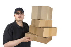 Delivery driver with a stack of parcels Royalty Free Stock Images