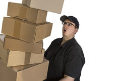 Delivery driver with a stack of parcels Stock Image