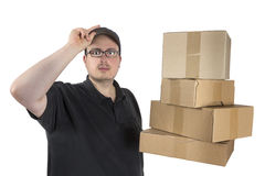 Delivery driver with a stack of parcels Stock Photos