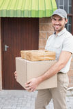 Delivery driver walking with parcels Stock Photography