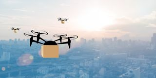 Delivery drone with the package. Against city background. Fast and convenient transportation concept stock photos