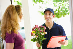 Delivery: Dropping Off Floral Arrangement Royalty Free Stock Photography