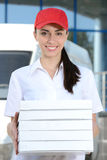 Delivery. Female courier delivery pizza on background car for pizza delivery Stock Image