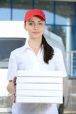 Delivery. Female courier delivery pizza on background car for pizza delivery Stock Photos