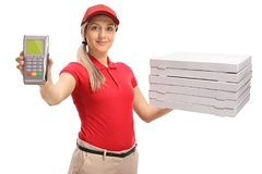 Delivery girl holding a payment terminal and a stack of pizza bo. Xes isolated on white background Stock Photo