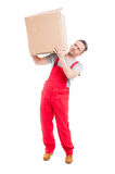 Delivery guy carrying big cardboard box like moving Stock Photography
