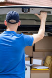 Delivery guy closing van doors Stock Photos