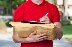 Delivery guy does his paperwork Royalty Free Stock Photos