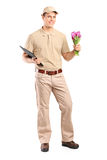 Delivery guy holding a bunch of flowers Stock Image