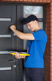 Delivery guy knocking on door stock image