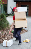 Delivery guy picking up parcels Royalty Free Stock Photography