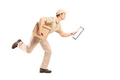 Delivery guy running with a cardboard box Stock Images