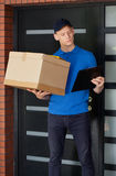 Delivery guy waiting for client Stock Images