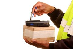 Delivery. Image of a delivery man at work with a pen and device Stock Image