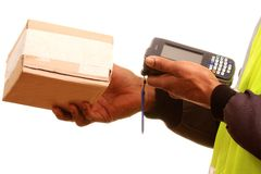 Delivery. Image of a delivery man at work with a pen and device Stock Photography