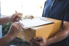 Delivery mail man giving parcel box to recipient and signature form, Young owner signing receipt of delivery package from post stock photos