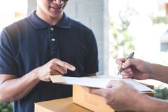 Delivery mail man giving parcel box to recipient and signature form, Young owner signing receipt of delivery package from post stock photo